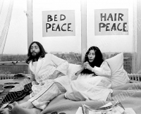 YJohn Lennon & Yoko Ono in bed, Guitar on the left side of John, Yoko folded hands