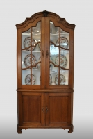 Dutch corner displaycabinet with a beautiful light patina, with the original glass in the upper doors.