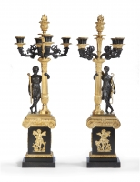 A pair of restauration ormolu and patinated bronze five-light candelabra.