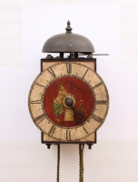 An Italian polychrome painted iron wall clock, circa 1700