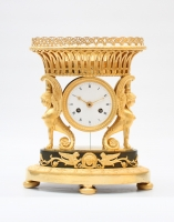 A French Empire ormolu and bronze urn mantel clock with griffins, circa 1800