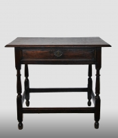 English table with drawer, made of oak, 18th century.