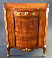 A kingwood and amaranth veneered commode