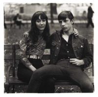 Young Couple on a bench in Washington Square Park, N.Y.C.