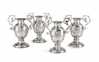 Set of four silver vases