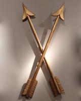 Four gilt wooden arrows