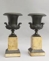 Bronze Medici vases on marble bases