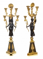 A pair of French five-light candelabra crowned with two peacock's