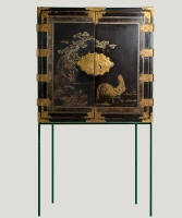 A Japanese Laquer Cabinet in picturial style