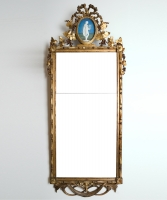 A Louis XVI Mirror with Medaillion