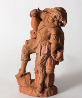 A Terracotta Sculpture of a Drinking Peasant
