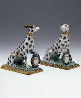 A Pair Polychrome Decorated Sitting Dogs in Brussels Earthenware