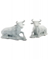 A Pair of Recumbent Cows in White Dutch Delftware