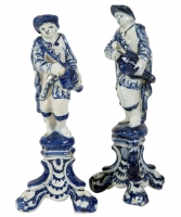 A Pair of Hurdy Gurdy players in Blue and White Dutch Delftware