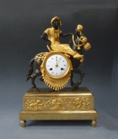 Superb gilt and patinated bronze sculptural mantel clock,