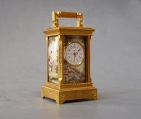 Attractive mini carriage clock , four enamelled panels, 8 day, Swiss circa 1890.