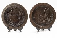 A lovely pair of far East bronze circular wall decoration circa 1880