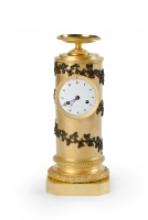 Cylinder shaped Empire mantel clock with leaf garlands