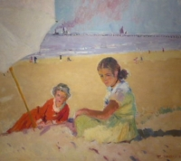 Two girls under a beach umbrella