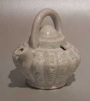 A small Chinese porcelain water dropper with a pale blue glaze. Qingbai ware, probably from Fujian province Yuan period 13/14th c CE H: 8cm ( incl overhead handle