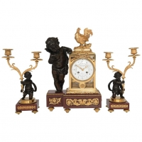A good 19th century decorative three piece ormolu clock set, signed  circa 1880