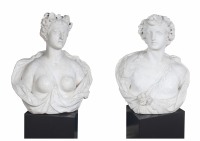 A pair of marble busts of Bacchus and Flora