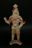 A Chinese pottery sculpture of a standing warrior. Tang dynasty ceramics from China