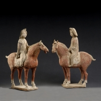 A pair of Chinese pottery fat ladies on horseback, Tang dynasty ceramic art from China