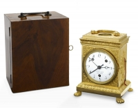 A Swiss gilt Pendule D' Officier, 8 days,  grande sonnerie, circa1810.  With the original mahogany travelling case