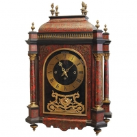 A good late 19th century English boulle work quarter chiming mantel clock