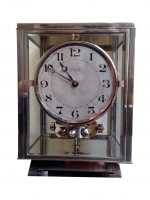 M211 Nickel plated art deco J. L. Reutter four-glass Atmos clock
