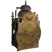 A very unusual 18th century clock  signed