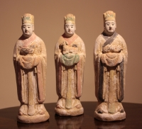 A set of Ming dynasty pottery sculptures of men with animals of the zodiac