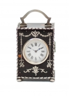 An English silver mounted tortoiseshell carriage timepiece by Comyns & Co, 1906