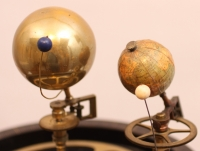 A rare French mantel clock with orrery, circa 1860