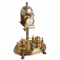 Desk inkwell with clock and ringing bell, circa 1860