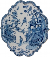 An Oval Chinoiserie Plaque in Blue and White Dutch Delftware