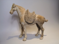 A WALKING HORSE WITH REMOVABLE SADDLE