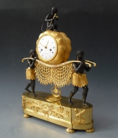 A fine and rare Empire 'Au Bon Savage' clock, 'The Stretcher Bearers' by Godeby à Paris, circa 1815
