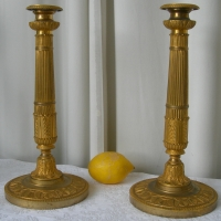 A PAIR OF FIRST EMPIRE CANDLESTICKS
