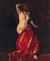 Zittend naakt met rode doek