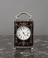 A small English tortoiseshell & silver travelling clock, by William Comyns, circa 1902
