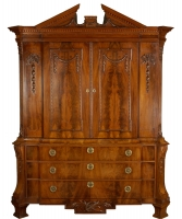A Neoclassical Break-Front Cabinet With Broken Timpan