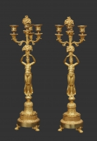 A pair of ormalu French 'Empire' Candlesticks, circa 1810