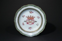 A pair of Chinese porcelain plates decorated in enamels with the De La Parra coat of arms