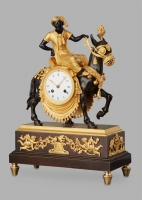 Unusual French 'Directoire' gilt and patinated bronze mantel clock with young Arab on mule, circa 1800