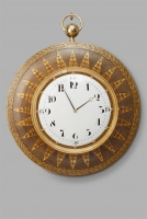A hugely decorative French Empire Wallclock, with White Enamel Dial and Arabic Numbers, circa 1820