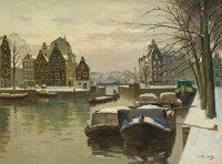 Barges covered with snow. Houtkopersburgwal in Amsterdam