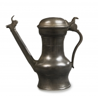 A pewter 'Jan Steen' jug