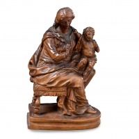A boxwood sculpture depicting Madonna and child